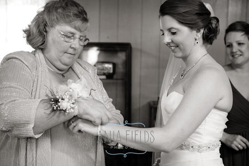 mom helping bride getting ready