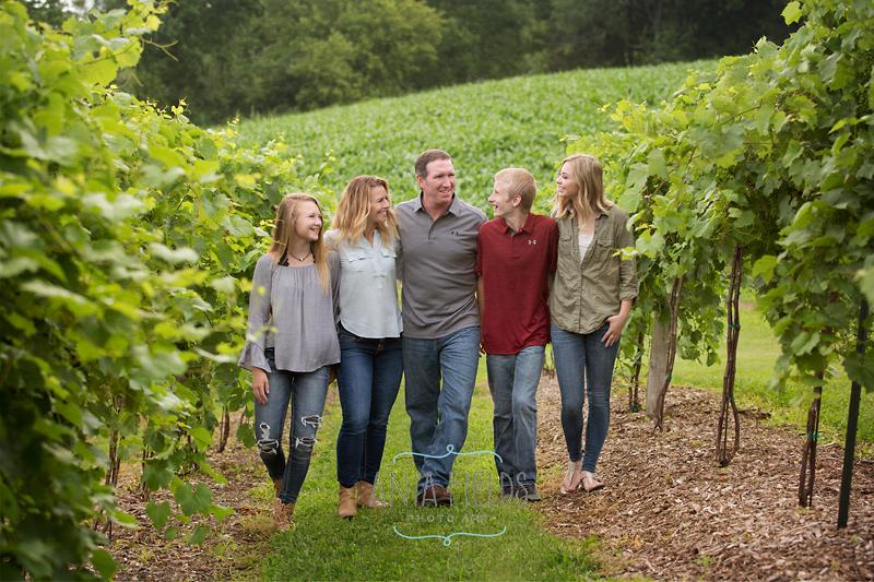 family walking in a vineyard