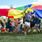 adults playing parachute games
